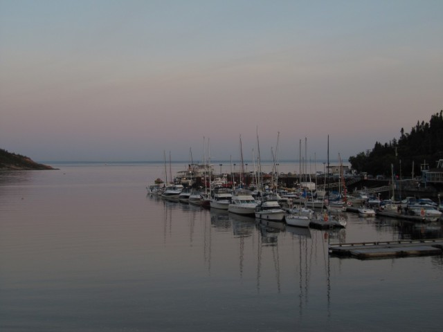 Boat pier in Tadoussac at sunset